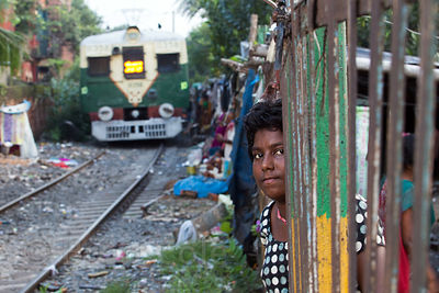 Girl on railway tracks, Ahiritola, Kolkata, India