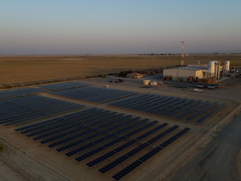 Commercial photo shoot for Sunpower Corporation demonstrating the utility and benefits of an industrial solar panel array in Bakersfield, California.