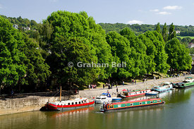 Boats on River Avon near Pulteney Bridge, Bath, Somerset, England.