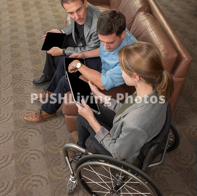 Young business woman in a wheelchair in a meeting