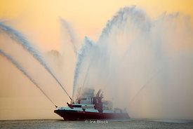 New York City FIre Department's state of the art Fireboat at the Macy's fourth of July Fireworks display on the Hudson River.  New Jersey is the background.