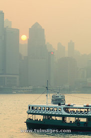 Sunset in Victoria Harbour of Hong Kong