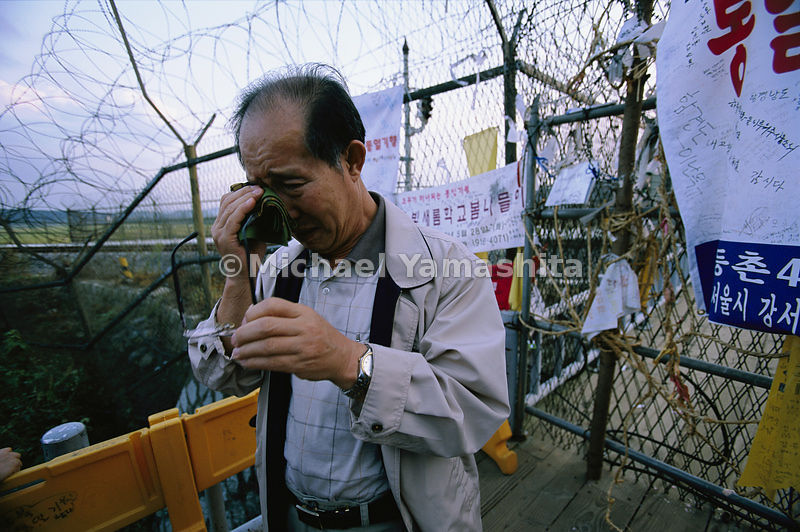 Korean man weeps for his family whom he has not seen in more than 55 years.