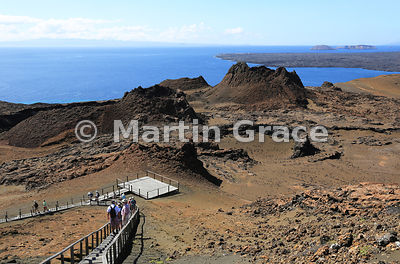 Looking over the walkway and volcanic spatter cones of Bartolome Island to Santa Cruz in the distance (left) and the lava flows of Santiago (right), Galapagos Islands