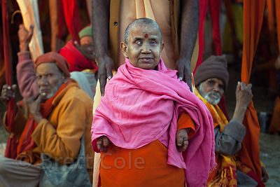 A woman with some type of disorder who is apparently revered, at a tent for Sadhus at the 2013 Kumbh Mela, Allahabad, India.