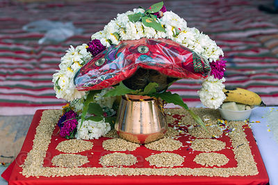 Flower arrangment and other offerings at a temple, Pushkar, Rajasthan, India