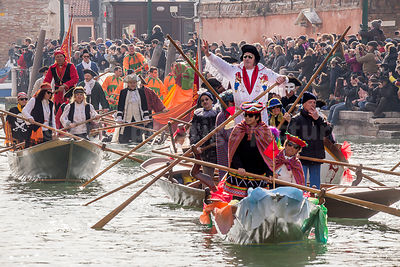 Boat with an Elvis Presley Impersonator in the Venice Carnival Water Parade  on the Rio di Cannaregio Canal