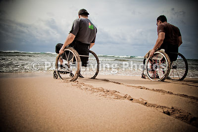 Hawaii wheelchair tracks in the sand