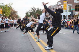 Members of the UI Gymnastics team perform in the  University of Iowa homecoming Parade on Clinton St in Iowa City on Friday September 28, 2012. (Justin Torner/Freelance)