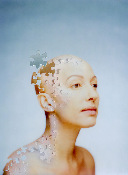 woman made of jigsaw puzzle pieces