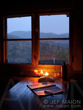 Candle-lit hut and nightscape