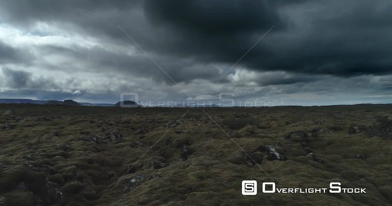 Flying Over Lava Field Moss Under Dark Stormy Sky Drone Footage Iceland