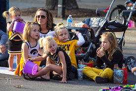Siena Bell, 2, Lila Bell, 6, Gwen Bell, Sofie Bell, 4, Bella Pourroy, 5, Rylee Pourroy, 5 watch as the 2012 University of Iowa homecoming Parade begins on Washington St in Iowa City on Friday September 28, 2012. (Justin Torner/Freelance)