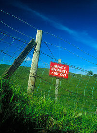 Bright Red Private Property Keep Out Sign in the countryside