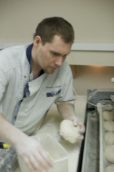 France - Paris - A baker makes bread at the Maison Morange Patisserie on the Rue Mouffetard