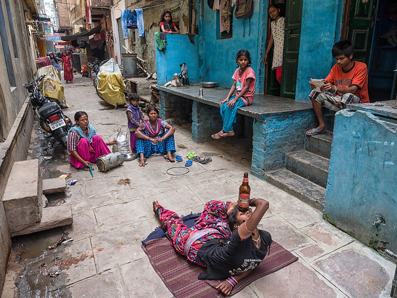 A group of local women perform a trick for the crowd at at the streets of Varanasi