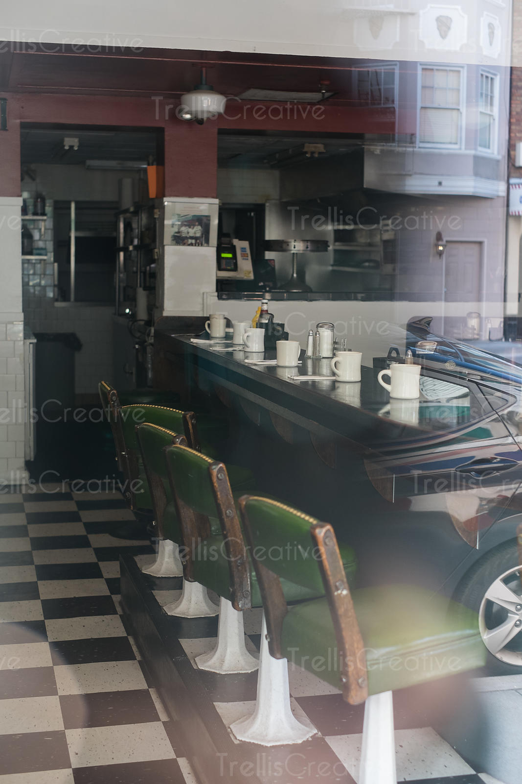 Interior of an old diner seen through window