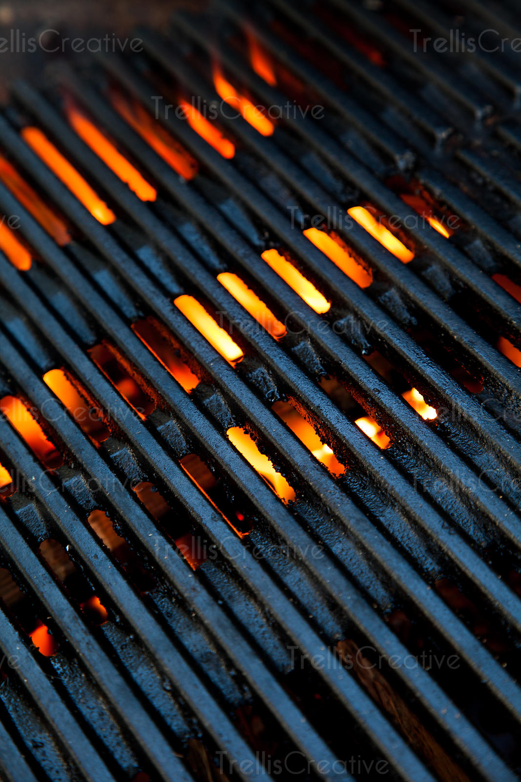 Embers of hot coals heat up the barbeque grill