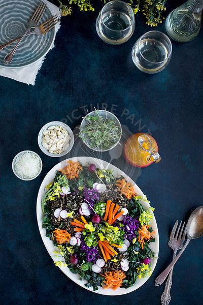 Kale Wild Rice Salad. Photographed on a dark blue background.