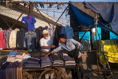 An Elderly Man Sells Clothes At A Makeshift Stall, Delhi,