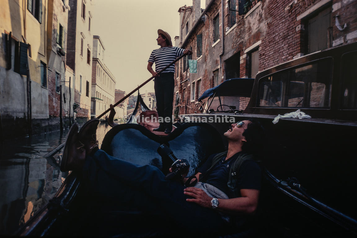 Michael Yamashita enjoys a leisurely moment on a gondola ride. Venice, Italy, 1982.