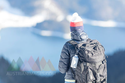 Germany, Bavaria, Alps, hiker with backpack at Lake Walchen