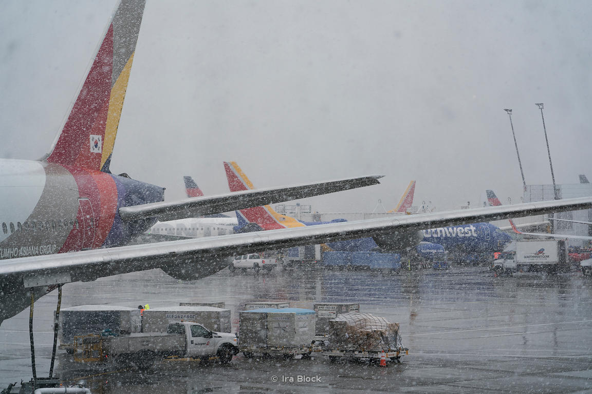 A view of the Seattle - Tacoma international airport ramp, apron on a snowy day.