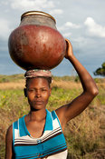 Woman carrying a clay pot, lake Niassa, Mozambique