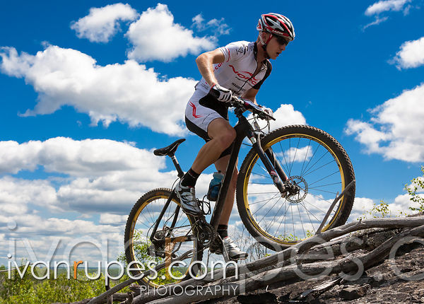 Andrew Watson (Norco Factory Team) on a rocky climb at the MTB XC Ontario Cup #5 - Naughton Trails, Sudbury, July 8, 2012