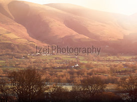 A cold morning over the small village of Applethwaite below the summit of Blencathra in the English Lake District, UK.