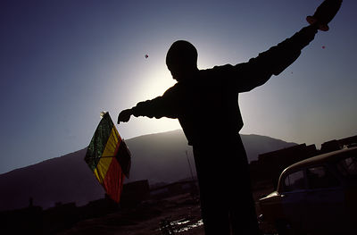 Afghanistan - Mazar-i-Sharif - A boy flys his kite