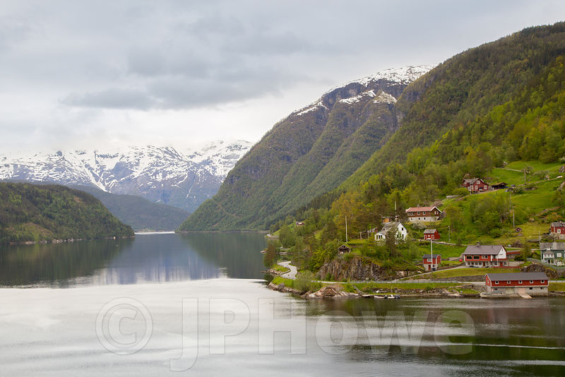 The Ulviken Fjord with Snow-Capped Mountains in the Distance and Traditional Coloured Houses