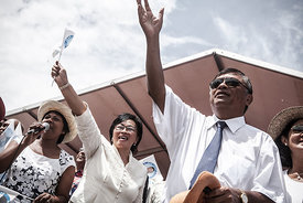 Jean Louis Robinson (2ndL), the Presidential candidate of the AVANA Party, addresses his last rally in Antananarivo on December 18, 2013 with former First Lady Lalao Ravalomanana (L), ahead of the upcoming presidential election on December 20. On December 20 voters are expected to choose a new president since President Andry Rajoelina seized power in a 2009 coup, with many hoping it will put an end to years of political turmoil.