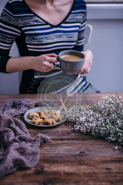 Woman having cookies and coffee