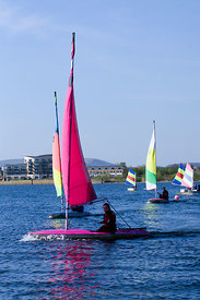 Group of children learning to sail dinghies, Cardiff Bay, Cardiff, South Wales, UK.