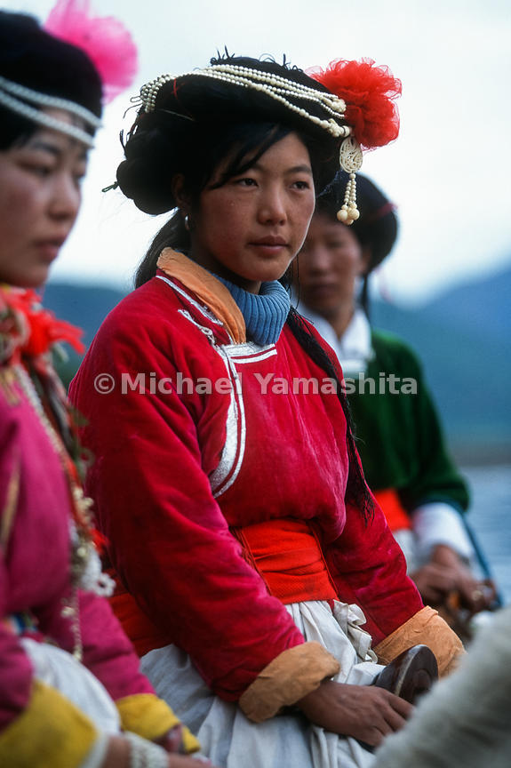 Mosuo tribal horsewomen. Most make their living in the tourist trade..Lugu Lake, Yunnan, China