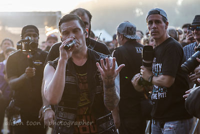 Brent Smith, vocals, Shinedown, walking through the pit, surrounded by photographers and security