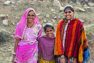 Happy girls and their mom in Kharekhari village, Rajasthan, India