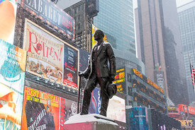 Statue of George M. Cohan at Times Square during a snow storm in New York, USA.