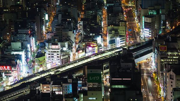 Bird's Eye: A Tight Shot of Kanda, Its Busy Train Station & Roads, At Night