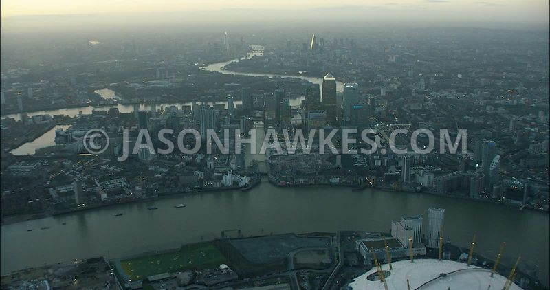 London Aerial Footage Canary Wharf with Greenwich Peninsula.