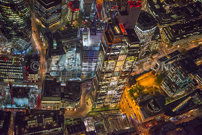 Night aerial view of The Heron Tower / Salesforce tower with it's famous rooftop restaurants and bars.