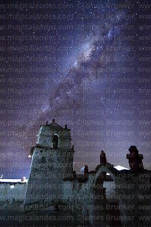 Milky Way Galactic Centre above church belfry and cairn in Parinacota village, Lauca National Park, Region XV, Chile