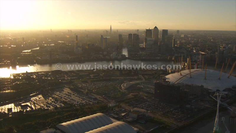 Aerial footage of the O2 Arena and Canary Wharf at sunset, London