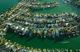 Aerial photograph of homes on man-made islands along Tampa Bay near St. Petersburg, Florida