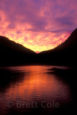 Deep red, purple and yellow sunset over Spiller Inlet in the Ingram-Mooto Wilderness, heart of the Great Bear Rainforest, British Columbia