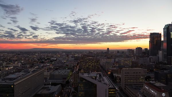 Bird's Eye: Brilliant Sunset With Low Level Stratus & Busy City Streets