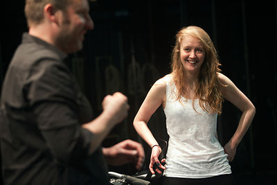 UK - Hull - Director Jamie Beale directs drama student Sarah Green from Hull University during a cycling sequence for an upcoming production of Cycle Song in the Gulbenkian Theatre