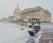 AOC clear Snow from East Front of U.S. Capitol .AOC's grounds crew gets to work clearing snow from the East Front Plaza of the U.S. Capitol to ensure the grounds are safe for staff and visitors arriving at the Capitol.