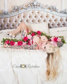Pinup-girl-pink-flowers-laying-on-bed